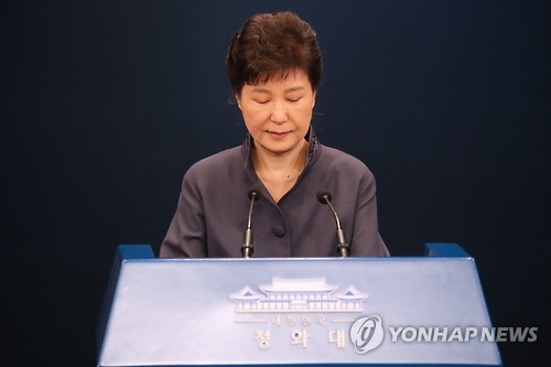In this file photo taken on Oct. 25, 2016, South Korean President Park Geun-hye closes her eyes after making a public apology over the leak of some confidential documents, including presidential speech drafts, to her confidant Choi Soon-sil to get advice from her at the presidential office Cheong Wa Dae in Seoul.
