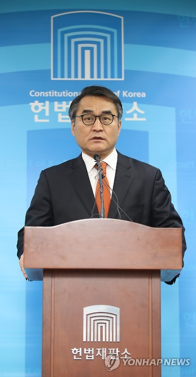 Bae Bo-yoon, spokesman of the Constitutional Court, holds a press conference at the court in Seoul on March 8, 2017, to say that the court will announce its ruling on the impeachment of President Park Geun-hye at 11:00 a.m. on March 10. The announcement will be broadcast live from the main courtroom.