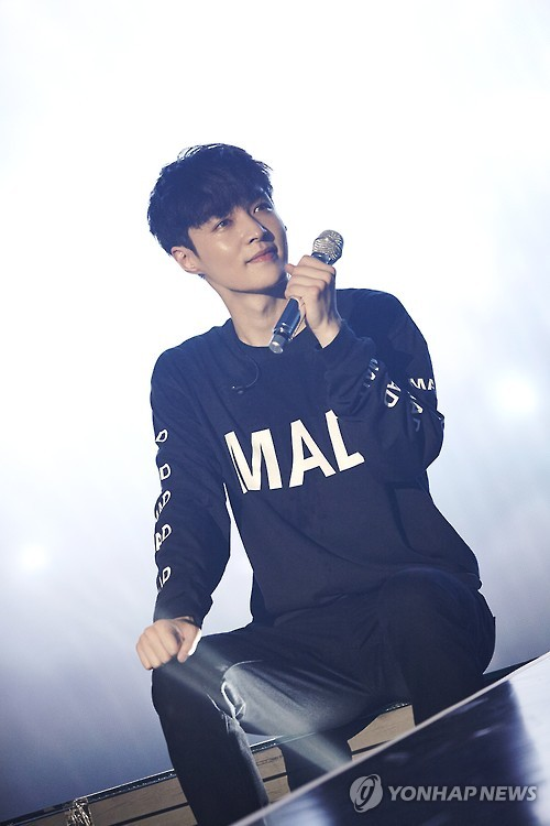 "In his photo provided by S.M. Entertainment, K-pop boy band EXO's Lay performs during the ""EXO PLANET #3 The EXO'rDIUM"" in Seoul on July 24, 2016."