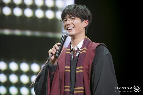 In this photo provided by Blossom Entertainment, Park Bo-gum smiles in a Harry Potter costume during a fan meeting at Seoul's Kyunghee University on March 11, 2017.
