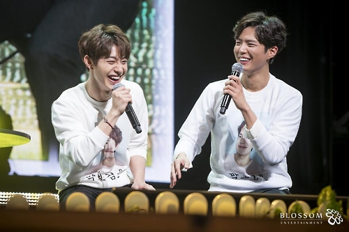 In this photo provided by Blossom Entertainment, Park Bo-gum (R) smiles during a fan meeting at Seoul's Kyunghee University on March 11, 2017