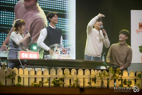 In this photo provided by Blossom Entertainment, Park Bo-gum (2nd from R) smiles during a fan meeting at Seoul's Kyunghee University on March 11, 2017.