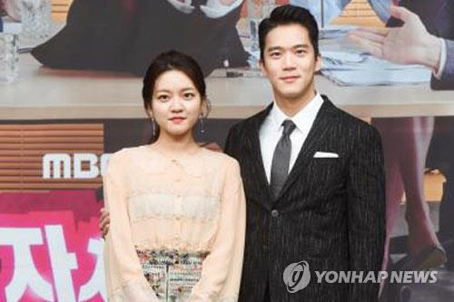 "Go Ah-sung (L) and Ha Seok-jin (R) pose for the camera at a media event for MBC TV's upcoming drama ""Radiant Office."""