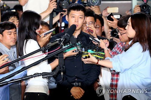 In this file photo taken on June 30, 2016, Park Yu-chun, a member of the popular K-pop boy band JYJ, appears at the Gangnam Police Station in southern Seoul to face questioning over his sexual assault allegations.