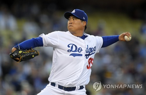 In this Associated Press photo, Ryu Hyun-jin of the Los Angeles Dodgers throws a pitch against the Colorado Rockies in the first inning at Dodger Stadium in Los Angeles on April 18, 2017. (Yonhap)