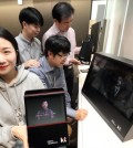 Employees of KT Corp. demonstrate a hologram call powered by the fifth-generation network technology in Seoul in this photo released by the mobile carrier on April 3, 2017. (Yonhap)