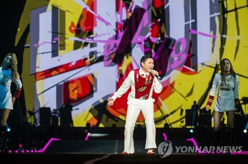This file photo provided by YG Entertainment shows South Korean pop musician Psy performing at a concert in Seoul on Dec. 24, 2016. (Yonhap)