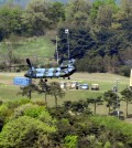 """Installing the Terminal High Altitude Area Defense system, known as Thaad, in Seongju, South Korea. An official at South Korea's Defense Ministry said on Thursday that the system would soon go into """"actual operation."""" Credit Lee Jong-hyeon/News1, via Reuters"""