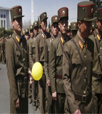 North Korean soldiers walk in the Ryomyong residential area after attending its official opening ceremony on Thursday, April 13, 2017, in Pyongyang, North Korea. Japan's Prime Minister Shinzo Abe, speaking at a parliamentary panel on national security and diplomacy, warned Thursday that North Korea may be capable of firing a missile loaded with sarin nerve gas toward Japan. (AP Photo/Wong Maye-E)
