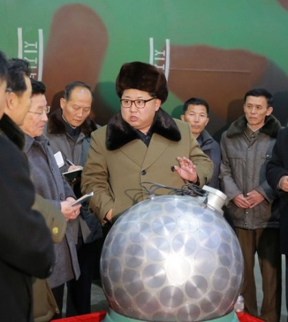 """The North Korean leader, Kim Jong-un, with what the C.I.A. calls """"the disco ball."""" The sphere is supposedly a nuclear weapon, shrunken to fit inside the nose cone of a missile. Credit Korean Central News Agency"""