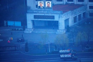 Trucks carried soldiers last week through central Pyongyang as the North Korean capital prepared for a parade marking the 105th anniversary of the birth of Kim Il-sung, the country's founding father, pictured in the upper-center at left along with Kim Jong-il, his son. DAMIR SAGOLJ / REUTERS