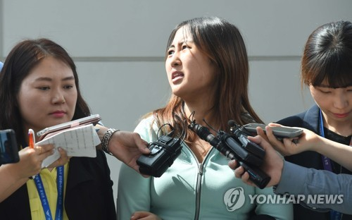 Chung Yoo-ra, the daughter of former South Korean President Park Geun-hye's close friend, speaks at Incheon International Airport, west of Seoul, on May 31, 2017, after being extradited from Denmark a day earlier. The 21-year-old Chung, who had been held at a detention center in the northern Danish city of Aalborg since January, was taken to the prosecutors' office in Seoul for questioning over allegations she received undue academic and financial favors based on her mother Choi Soon-sil's ties with the former president. (Yonhap)