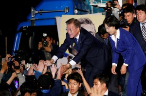 South Korea's president-elect, Moon Jae-in, and the Democratic Party of Korea's leader, Choo Mi-ae, greeting supporters at Gwanghwamun Square in Seoul. Credit Kim Kyung-Hoon/Reuters
