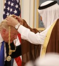 Saudi King Salman bin Abdul Aziz presents President Trump with his nation's highest civilian honor. (Evan Vucci/Associated Press)