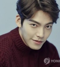 In this file photo, actor Kim Woo-bin poses for an interview with Yonhap News Agency at a studio in Seoul on Dec. 19, 2014. (Yonhap)  odissy@yna.co.kr