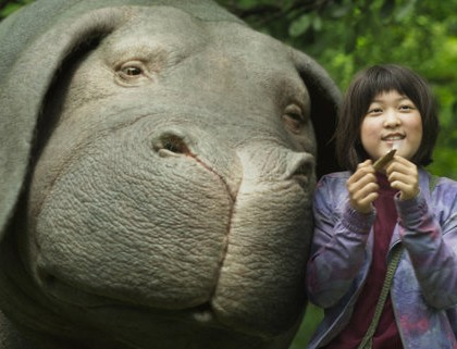 "The computer-generated Okja, left, and An Seo Hyun in ""Okja."" Credit Netflix"
