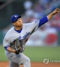 In this Associated Press photo, Ryu Hyun-jin of the Los Angeles Dodgers throws a pitch against the Los Angeles Angels at Angel Stadium of Anaheim on June 28, 2017. (Yonhap)