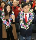 The file photo, taken on April 14, 2016, captures Shim Eun-ha (L), a retired actress, holding hands with her husband Ji Sang-wuk (R), then a candidate for the Saenuri Party, after he won his parliamentary seat in the general elections in Seoul. (Yonhap)