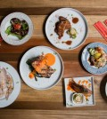 From left, bacon carpaccio, pork jowl, chef's bacon steak, bacon schnitzel, bacon sushi, eggplant rice and fresh pasta at Belly. Credit Alan Winslow for The New York Times