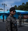 South Korean soldiers in the border-straddling village of Panmunjom on the Demilitarized Zone in April. Nearly half of the South's population lives within 50 miles of the border, well within the range of some of the North's artillery. Credit Lam Yik Fei for The New York Times