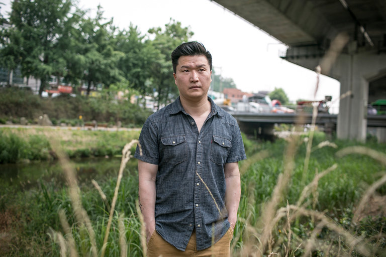 Adam Crapser near his home in Seoul. He is one of at least half a dozen adoptees in South Korea who were deported from the United States because their adoptive parents failed to get them citizenship. Credit Jean Chung for The New York Times