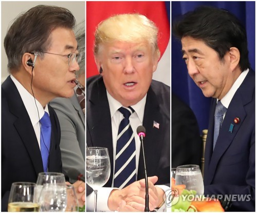 This compilation of photos shows South Korean President Moon Jae-in (L), U.S. President Donald Trump (C) and Japanese Prime Minister Shinzo Abe speaking at a trilateral luncheon meeting in New York on Sept. 21, 2017. (Yonhap)