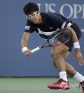 In this photo taken by the Associated Press on Aug. 30, 2017, South Korean tennis player Chung Hyeon competes against John Isner of the United States during their second round men's singles match at the U.S. Open at Billie Jean King National Tennis Center in New York. (Yonhap)