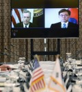 Robert Lighthizer, left on screen, the United States trade representative, attended a video conference with Trade Minister Kim Hyun-chong of South Korea last month. Credit Yonhap, via European Pressphoto Agency