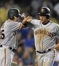In this Associated Press photo taken on July 28, 2017, Hwang Jae-gyun of the San Francisco Giants (R) is congratulated by Matt Moore after scoring a run against the Los Angeles Dodgers in the teams' Major League Baseball game at Dodger Stadium in Los Angeles. (Yonhap)