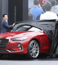Sang Yup Lee, a head of Genesis Styling, left, and Luc Donckerwolke, a head of Genesis Design Center, second from right, unveil the new sedan Genesis G70 during its an unveiling ceremony in Hwaseong, South Korea, Friday, Sept. 15, 2017. Hyundai Motor will launch its first midsize sports sedan under the Genesis brand in South Korea next week and in the U.S. early next year, the latest attempt by the emerging Korean luxury brand to challenge BMW's 3 series and other European premium cars. (Photo: Lee Jin-man, AP)