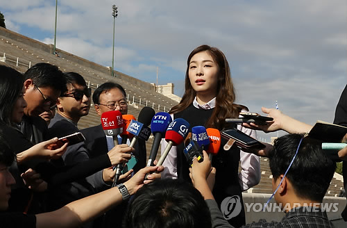 Former Olympic figure skating champion Kim Yu-na, also an honorary ambassador for the 2018 PyeongChang Games, speaks to reporters before the dress rehearsal of the Olympic flame handover ceremony at the Panathenaic Stadium in Athens on Oct. 30, 2017. (Yonhap)