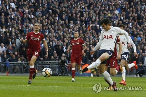 In this photo taken by the Associated Press, Tottenham Hotspur's South Korean forward Son Heung-min (R) scores his club's second goal against Liverpool during their English Premier League match at Wembley Stadium in London on Oct. 22, 2017. (Yonhap)