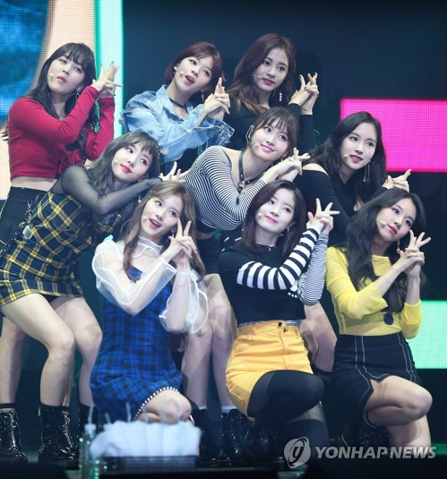 "TWICE performs during a media showcase for ""Twicetagram"" at Yes24 Live Hall in eastern Seoul on Oct. 30, 2017. (Yonhap)"