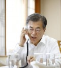 The photo provided by the presidential office Cheong Wa Dae shows President Moon Jae-in holding a telephone conversation with U.S. President Donald Trump on Nov. 29, 2017. (Yonhap)