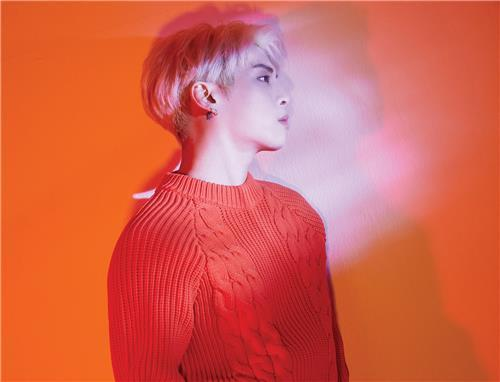 "This image, provided by S.M. Entertainment, shows the cover for Jonghyun's final album ""Poet