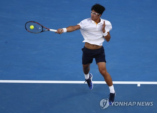 In this photo taken by the Associated Press on Jan. 22, 2018, South Korea's Chung Hyeon hits a forehand return to Serbia's Novak Djokovic during their round of 16 match at the Australian Open tennis championships in Melbourne, Australia. (Yonhap)