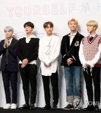 "This file photo shows South Korean boy group BTS posing for a photo during a showcase for the group's EP album ""Love Yourself: Her"" in Seoul on Sept. 18, 2017. (Yonhap)"