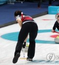 South Korean curlers sweep the ice sheet in the PyeongChang Winter Games women's curling semifinals against Japan at the Gangneung Curling Centre on Feb. 23, 2018. (Yonhap)