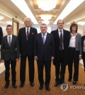 International Olympic Committee (IOC) President Thomas Bach (C) and North Korean IOC member Chang Ung (3rd from L) pose with members of an IOC delegation in Pyongyang on March 29, 2018, in this photo from the North's Korean Central News Agency. (For Use Only in the Republic of Korea. No Redistribution) (Yonhap)