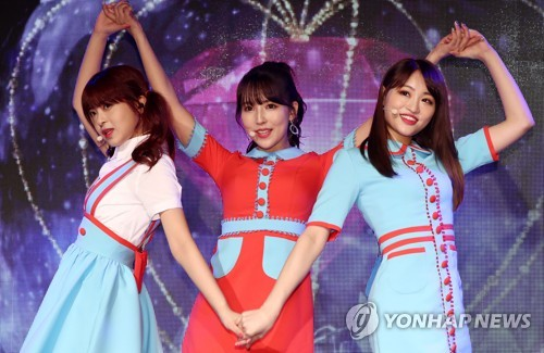 In this file photo, Honey Popcorn, a girl group comprised of Japanese adult video actresses, performs during a showcase for the its debut album in Seoul on March 21, 2018. (Yonhap)