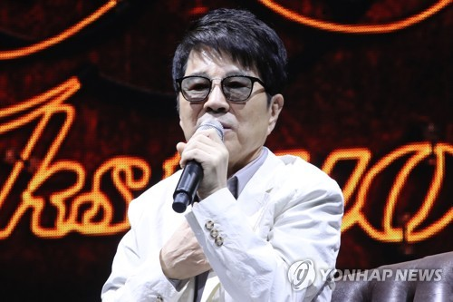 Veteran Korean pop singer Cho Yong-pil speaks to reporters at a press conference held at Blue Square in central Seoul on April 11, 2018. (Yonhap)