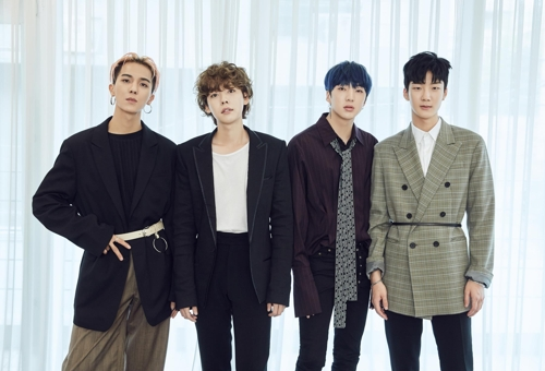 "This photo provided by YG Entertainment shows members of K-pop band WINNER posing for photos during a group media interview for their latest album, ""EVERYD4Y,"" on April 4, 2018, in Seoul."