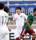 Mexico's Christopher Brayan Trejo (R) celebrates after scoring a goal against South Korea at the 2018 Suwon JS Cup U-19 football tournament at Suwon World Cup Stadium in Suwon, Gyeonggi Province. (Yonhap)