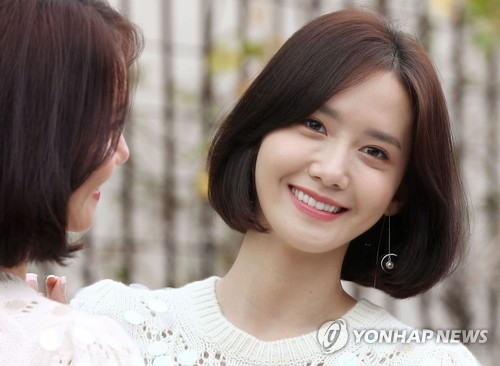 "Yoona, a member of girl group Girls' Generation who has also picked up acting, poses for photos ahead of an interview in Seoul on Sept. 19, 2017. She starred in the TV drama ""The King Loves"" that ended on the day. (Yonhap)"
