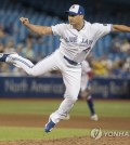 In this Associated Press photo, Oh Seung-hwan of the Toronto Blue Jays throws a pitch against the Minnesota Twins in the top of the ninth inning of a Major League Baseball regular season game at Rogers Centre in Toronto on July 24, 2018. (Yonhap)