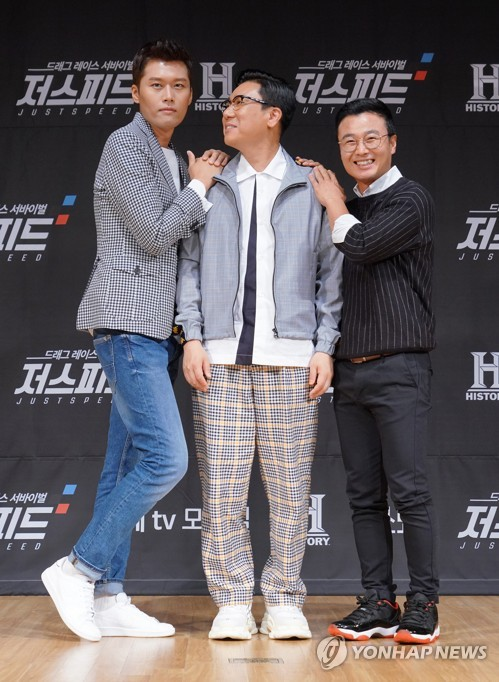 "TV personality Lee Sang-min (C) attends an event in Seoul on July 3, 2018, to promote cable television History Channel's upcoming drag racing survival program ""Just Speed,"" in this photo courtesy of KT Corp. The program will also be available on Olle TV mobile. (Yonhap)"
