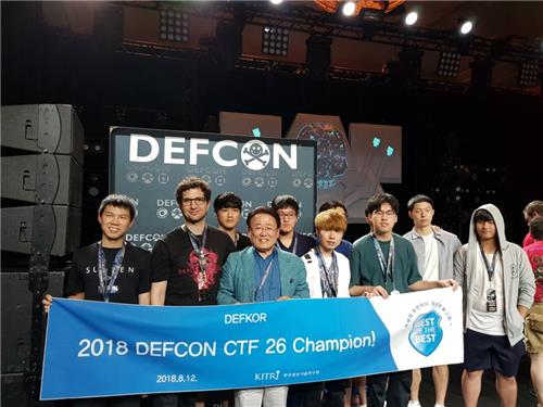 "This photo provided by the Ministry of Science and ICT on Aug. 13, 2018 shows a South Korean team, ""DEFKOR00T,"" at DEFCON 26. (Yonhap)"