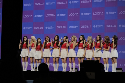"This image provided by BlockBerry Creative shows K-pop girl band Loona releasing their first album ""+ +"" with the full 12 members in a showcase held in central Seoul on Aug. 20, 2018. (Yonhap)"