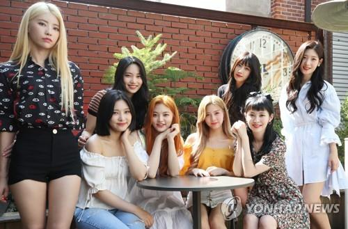 The eight members of DIA pose for photos during an interview on Aug. 22, 2018. (Yonhap)