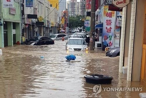 A street in the southwestern city of Gwangju is flooded on Aug. 28, 2018, after overnight downpours, in this photo courtesy of the city's fire agency. (Yonhap)